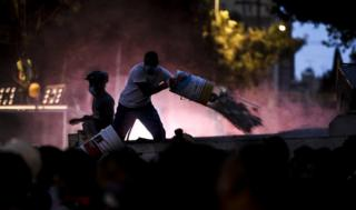 Man clearing rubble in the dark in Mexico City after the devastating earthquake struck on 19 September 2017