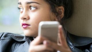 Teenager using smartphone