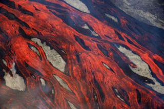Lava flows ooze over the ground at the Piton de la Fournaise volcano on Reunion.