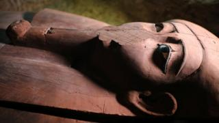 A wooden coffin inside the recently discovered burial site in Minya, Egypt