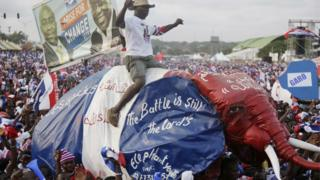 Supporters of New Patriotic Party Presidential candidate Nana Akufo-Addo, chant slogans during a presidential election rally in Accra, Ghana, Sunday, Dec. 4, 2016.