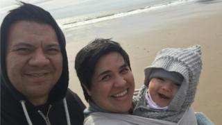 Jonathan Kidwell with wife Ffion and son Gwilym at Caswell Bay, Swansea