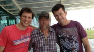 Jeroen Oerlemans (left), Shane Bell from the New York Times (middle, pixelated) and John Cantlie (right) outside Hatay Airport in Syria on their way back to London (07 August 2012)