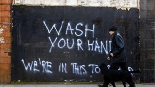 Wash your hands graffiti in Belfast