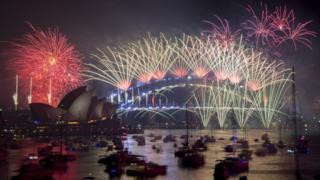 Fireworks explode over the harbour and the Sydney Harbour Bridge landmark during New Year's celebrations in Sydney, Australia, 1 January 2019