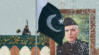 The portrait of Muhammad Ali Jinnah is seen at at the India-Pakistan Wagah border post during a ceremony to celebrate Pakistan's Independence Day on 14 August 2017