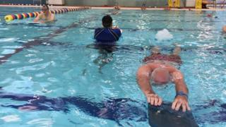 Adult learners in the swimming pool in Derry.
