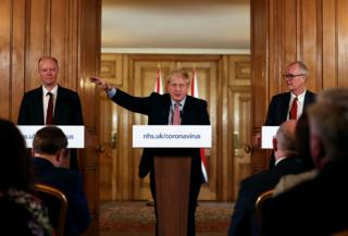 The Prime Minister pictured at previous press conference with UK chief medical adviser, Prof Chris Whitty (L) and and Sir Patrick Vallance (R), the UK's chief scientific adviser
