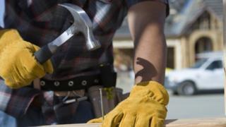 Builder hammering