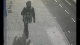 The suspect pictured walking in Deptford Broadway on 2 December