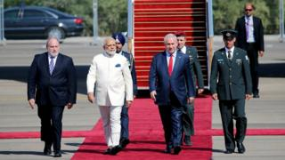Israeli Prime Minister Benjamin Netanyahu (2nd R) welcomes Indian Prime Minister Narendra Modi (2nd L) during an official welcoming ceremony upon his arrival in Israel at Ben Gurion Airport, near Tel Aviv, Israel 4 July 2017