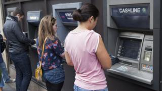 people at cash machine in Edinburgh