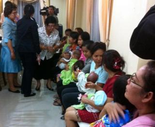 Thai nannies holding nine suspected surrogate babies after a police raid at a residential apartment