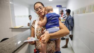 Mother and her baby at a clinic in Brazil