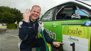 Manus Kelly in a Subaru Impreza WRC S12B celebrates at the end of stage 20 Glen after winning during the Joule Donegal International Rally