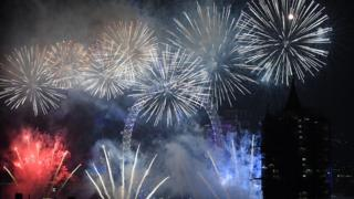 Fireworks explode over the London Eye