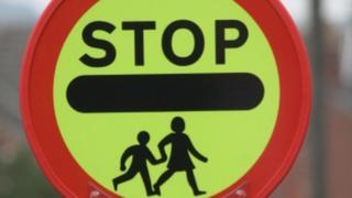 School patrol stop sign