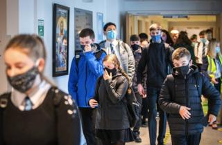 "Students at St Columba""s High School, Gourock, wear protective face masks as they head to lessons as the requirement for secondary school pupils to wear face coverings when moving around school comes into effect across Scotland"