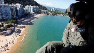 An air force soldier in a helicopter takes part in a patrol during a military police strike over wages, along Costa beach in Vila Velha, Espirito Santo, Brazil, February 11, 2017