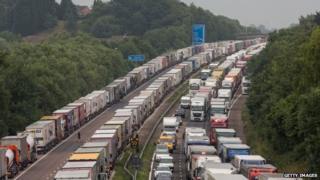 Lorries queue on four lanes across the motorway