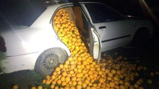 A car transporting thousands of oranges allegedly stolen from a warehouse, in Seville, Spain.