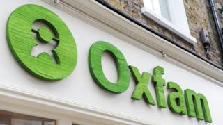 An Oxfam sign above one of its shops