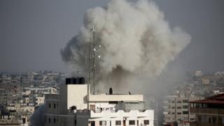 Smoke rises during an Israeli air strike in the southern Gaza Strip