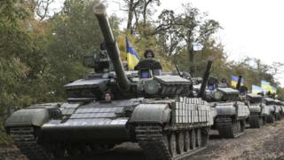 Ukrainian tanks are pulled back from the frontline in the east