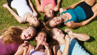 A group of happy girls lying down