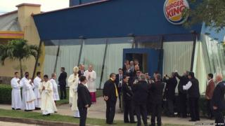 Pope Francis stands outside the Burger King franchise that served as a makeshift sacristy for today's open air mass in Santa Cruz, Bolivia.