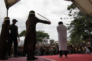 Two men are caned in Indonesia's Aceh province for gay sex (23 May, 2017).