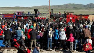 People watch as replicas of the historic Jupiter and No 119 steam locomotives meet