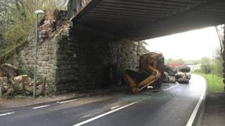 Digger and tractor strike Crossgates bridge in Powys