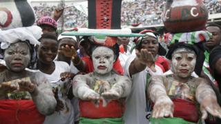 Supporters of Ghana Incumbent President, John Dramani Mahama candidate of the National Democratic Congress perform during a presidential election rally at Accra Sports Stadium in Accra, Ghana, Monday, Dec. 5, 2016. The Ghana election will take place on Dec. 7.
