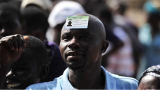 Male voter put im voters card for head.