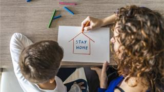 child-and-mother-drawing-stay-home-sign