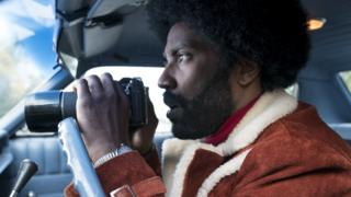 "El actor John David Washington en el papel de Ron Stallworth en la película ""BlacKkKlansman""."