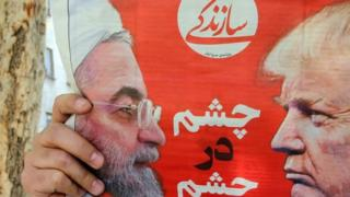 Presidents Rouhani and Trump on a newspaper in Tehran