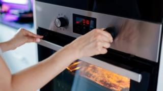 Person using electric cooker