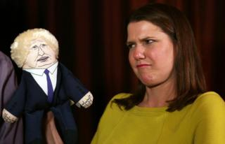Jo Swinson with a puppet of Prime Minister Boris Johnson