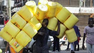 Man carrying empty jerry cans in Nairobi, Kenya - Friday 18 January 2019