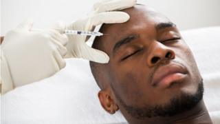 Man having forehead injected