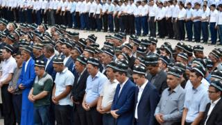 Uzbek men pray as they gather to pay the last respects, during the funeral of President Islam Karimov at the historic Registan Square in Samarkand, Uzbekistan, Saturday, Sept. 3, 2016.