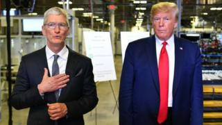 Technology US President Donald Trump (r) and Apple CEO Tim Cook speak to the press during a tour of the Flextronics computer manufacturing facility.