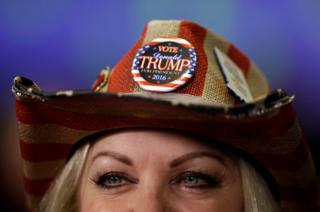 Donna Deer, a supporter of Republican presidential candidate Donald Trump, waits to be interviewed during an election night rally in Indianapolis