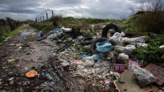 Rubbish dumped at the end of a country lane