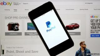 PayPal on phone in front of Ebay page