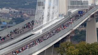 Walkers on bridge