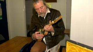 Robert Plant playing the stained glass mandolin
