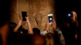 Tourists taking photos of a statue of Ramses II at the Abu Simbel Temple south of Aswan, Egypt - Monday 22 October 2018